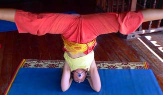 Kali doing headstand splits